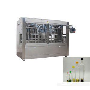 automatický stroj na plnenie sklenených fliaš jahodovej marmelády